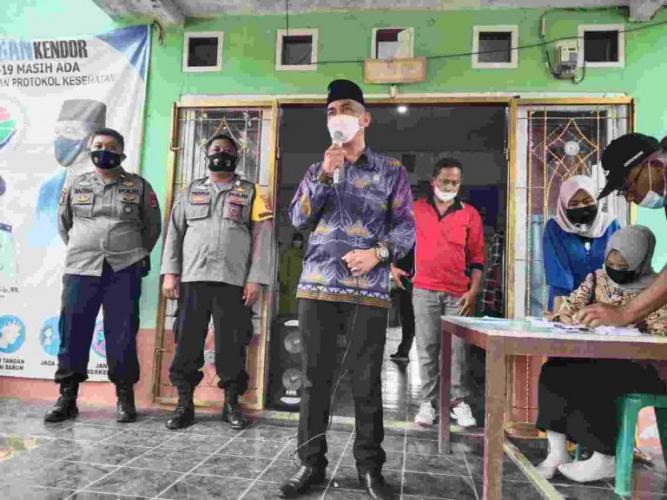 Vaksinasi Pertama, Kepala Desa Bumi Jaya Berharap Masyarakat Bisa Divaksin Semua dan Tetap Jaga Prokes